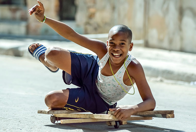 Cuban boy and homemade skateboard.