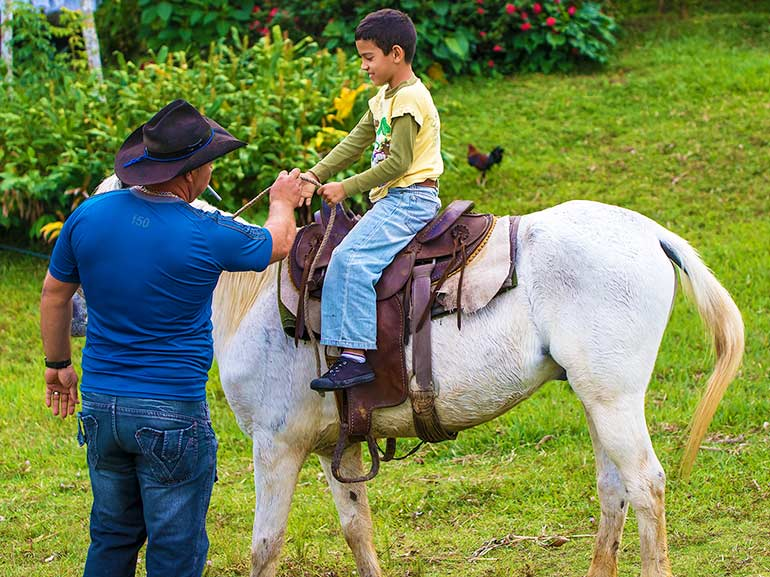 Cuban boy learns to ride a horse.