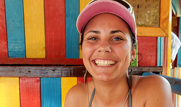 Cuban woman at beach kiosk.